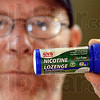 I quit: Club Soda worker Russell Moffatt shows his nicotine lozenge container as he announces he's quitting smoking starting today. He was able to quit once before for a long period and started again about a year ago.