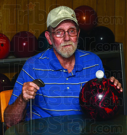Tribune-Star/Jim Avelis<br /> Multi talented: Sherm Wilkins recently bowled a 300 game, just a few days after  scoring a hole in one in golf.