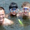 Experience: J.R. Simma, son Nathan and friend Brent Bohnert at Simma's lakeside home in Riley Sunday afternoon. The three experienced a diving expedition gone bad in Cancun, Mexico.