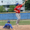 Leap: Post 346 shortstop Scott West leaps to catch a ball thrown to second base from the outfield as a Floyds Knobs baserunner gets to the bag during Sunday's Regional Championship game. 346 won the game 6-1.