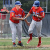 Homer handshake: Tony Rosselli shakes hands with John Hayes as he rounds third base enroute to score after hitting a solo home run during Sunday's Regional Championship game against Floyds Knobs.