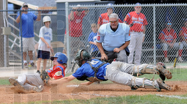 Score: Kodie Girton slides into home and scores just ahead of the tag by Floyds Knobs catcher Logan Richey during Sunday's Regional Championship game.