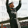 Jimmie Johnson celebrates his win at the NASCAR Sprint Cup Series auto race at Indianapolis Motor Speedway, Sunday, July 29, 2012, in Indianapolis. (AP Photo/Autostock, Matthew T. Thacker)  MANDATORY CREDIT