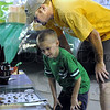 Buddies: Mason Bolding and his father Michael look at a 4-H display at the Vigo County Fairgrounds Sunday evening.