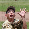 Fielding: Clinton pitcher Brogan Sanders fields a ball during game action against the North Terre Haute 11-12 team.