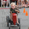 Into it: Six-year-old Terre Haute resident Carson Bonar takes his turn at the tractor pulling event at the Vigo County Fairgrounds Sunday evening.