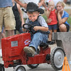Cowboy: Three-year-old Lane Tucker participates in the tractor pulling competition at the Vigo County Fair Sunday evening.