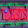 Tickets: Detail of neon sign at Ticket booth.