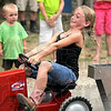 Strain: Nine-year-old Kaityn Ray of West Terre Haute puts everything into the tractor pulling event during activities at the Vigo County Fair Sunday evening.