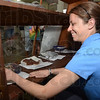 Tribune-Star/Jim Avelis<br /> Entries: Katarina Walker of the Purdue Home Extension office places brownies in the display case at the Vigo County Fair. The King Arthur Flour Brownie Baking contest was held Friday.