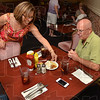 Tribune-Star/Joseph C. Garza<br /> Slice of Heaven: Cathy Azar sets a piece of mandarin orange cake on the table for customers Joann and Walt Roberts Friday at the Saratoga Restaurant. Walt and his wife, Runette Roberts, who now live in Greenwood, were visiting Joann and decided to have lunch at the Saratoga.