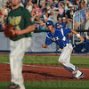 Tribune-Star/Jim Avelis<br /> Running: Rex baserunner Casey McCurdy bluffs a steal in their game with Quincy Friday night.