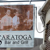 Tribune-Star/Joseph C. Garza<br /> Family founders: A sign on the fifth-street side of the Saratoga Restaurant features a photo of brothers Joe and Abe Malooley. Abe Malooley is the father of owner, Cathy Azar.