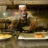 Tribune-Star/Joseph C. Garza<br /> Restaurant life: Saratoga Restaurant owner George Azar cooks lunch Friday afternoon at the downtown establishment.