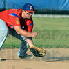 Tribune-Star/Jim Avelis<br /> Scoop: Post 346 shortstop Scott West fields a ground ball early in their game with Sullivan.