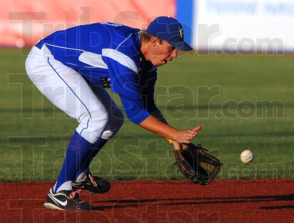 Tribune-Star/Jim Avelis<br /> Nick of time: Terre Haute Rex shortstop Nick Johnson fields a ground ball in their Friday game with the Dubois County Bombers.
