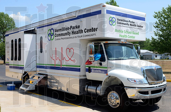 Tribune-Star/Joseph C. Garza<br /> Health on wheels: The new mobile school-based health center will be able to serve about 5,000 children in the area served by the Vermillion-Parke Community Center. A dedication for the new mobile center was held Friday at South Vermillion High School.