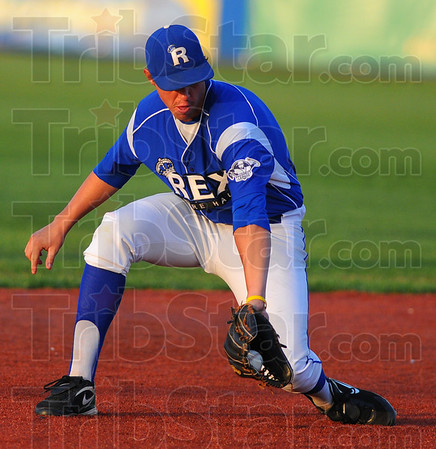 Tribune-Star/Jim Avelis<br /> Stopper: Terre Haute Rex shortstop Nick Johnson gloves a groundball for an out. The play held a Dans runner at second base and his throw to first recorded and out.