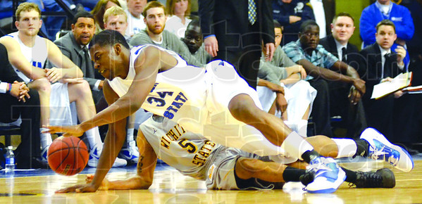 Hustle: Indiana State center Myles Walker goes to the floor for a loose ball during first half action against Wichita.