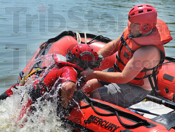 Tribune-Star/Jim Avelis<br /> Like this: Sugar Creek firefighter Josh Milbourn pulls instructor Hidekatsu Kajitani into his boat, demonstrating one of the methods used to get someone out of the water.