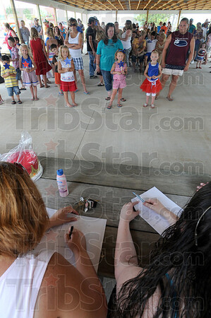 Tribune-Star/Jim Avelis<br /> No pressure: Contestants for the title of Montezuma's Miss Firecracker line up in front of the judges. The Saturday festivities included a parade, the pageants and a fish fry.