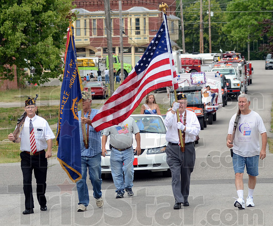 Tribune-Star/Jim Avelis<br /> Remembering: Members of American Legion Post 48 lead the Montezuma Independence parade through town Saturday morning.