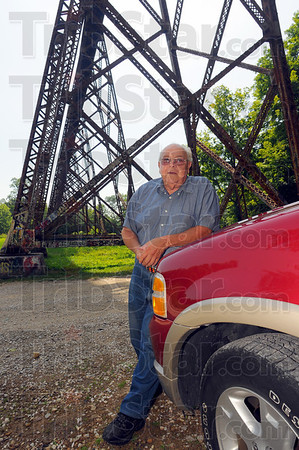 Tribune-Star/Jim Avelis<br /> It'll talk to you: Larry Schute tells of how the Tulip Trestle will talk to a person with snaps and pops as the sun warms the steel, or as it cools down at night.