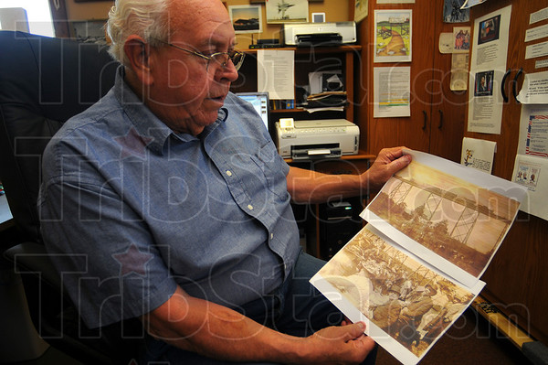 Tribune-Star/Jim Avelis<br /> That was then: Larry Schute of Solsberry has been enamored of the Tulip Trestle for years. Here he holds two photographs from the early days of the structure, from about 1908.