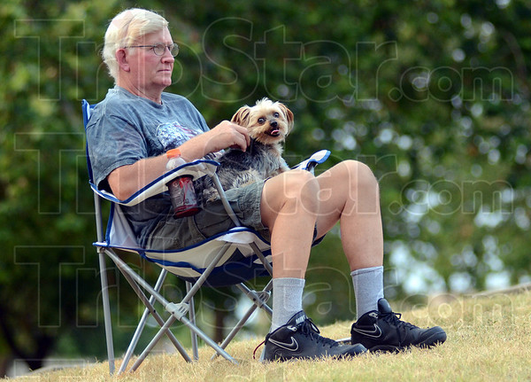 """Hot dog: Brazil resident Raymond Smith and his dog """"Ivan"""" watch the 555th Air Force Band Saturday evening at Fairbanks Park."""