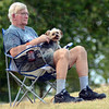 "Hot dog: Brazil resident Raymond Smith and his dog ""Ivan"" watch the 555th Air Force Band Saturday evening at Fairbanks Park."