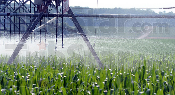 Tribune-Star/Jim Avelis<br /> Heat relief: A Montezuma cornfield is irrigated mid-morning Saturday. Dry weather and extreme heat has driven farmers to the extra expense of irrigating their crops.