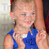 Tribune-Star/Jim Avelis<br /> Pick me: Mackenzie Nickle tries to catch the judges eye in the Little Miss Firecracker pageant Saturday morning. The contest was part of the Montezuma Independence Celebration.