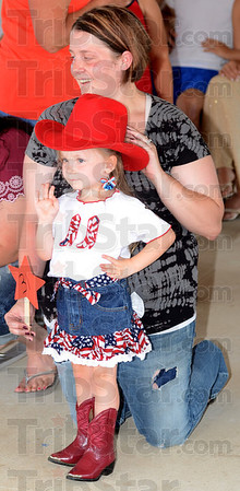 Tribune-Star/Jim Avelis<br /> Howdy: Kloey Jones sports her cowgirl clothes as she competes for the title of Miss Firecracker at the Montezuma Independence Celebration Saturday. With her is her mom Kristie.