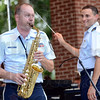 Sax solo: MSgt Stanley George performs during Saturday's concert at Fairbanks Park. Directing the band is Second Lieutenant Steven Ortiz.
