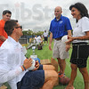 Tribune-Star/Jim Avelis<br /> Helping the hometown: Steve Weatherford talks with Troy Fears and Claudia Tanoos as he autographs footballs for the United Way. The New York Giants punter held a football camp Saturday at his alma mater Terre Haute North.