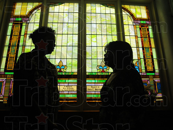 Tribune-Star/Jim Avelis<br /> Restored: Cynthia Hadley and Shirley Perez chat in front of the stained glass windows in Allen Chapel. The congregation celebrates its 175th anniversary this weekend.