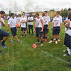 Tribune-Star/Jim Avelis<br /> How to move: Eastern Illinois University wide receiver Erik Lora explains moves that will help a referee see the feet of a player. He was one of several college players helping out at the Steve Weatherford football camp Saturday at Terre Haute North.