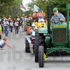 John Deere green: An antique John Deere tractor pulls passengers along the 4-H parade route Saturday afternoon.