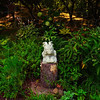 Tribune-Star/Joseph C. Garza<br /> Grotesque on guard: A grotesque sits on a tree stump among the natural flora on Brenda and Phil Milliren's property in northern Vigo County.