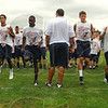 Tribune-Star/Jim Avelis<br /> Loosen up: Football player in Steve Weatherford's football camp go through warmup drills Saturday morning at Terre Haute North.