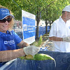 Tribune-Star/Jim Avelis<br /> Aw shucks: Cheri Bradley shucks sweet corn that will be part of a citrus marinade for their entry in the Clabber Girl barbecue competition Saturday. Her husband, Indiana State University president Dan Bradley is on the right.