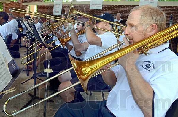 Brass: Members of the Marshall City Band and Brazil Concert Band perform together Saturday at Fairbank Park.