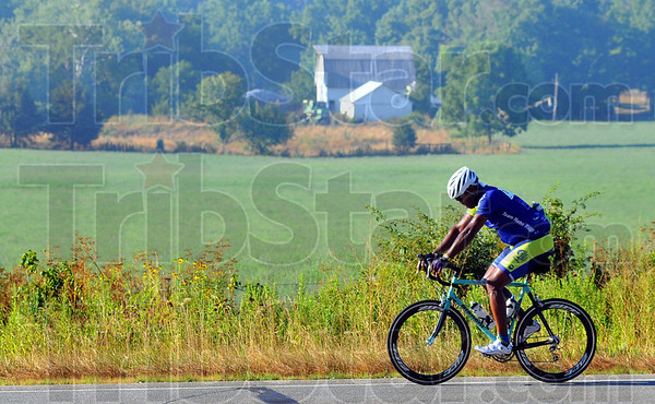Tribune-Star/Jim Avelis<br /> Solitude: A lone rider pushes along US 40 in Putnam County Saturday morning as he participates in the RAIN(Ride Across INdiana.