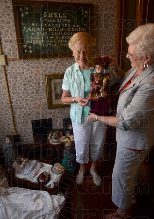 Tribune-Star/Joseph C. Garza<br /> For the small ones: Each room at the Vigo County Historical Museum has a theme and one is decorated as a nursery and features various antique dolls and furniture. Here, Barb Carney and Marylee Hagan straighten the hat on one of the room's inhabitants.