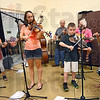 Kids: Members of the Coon Hollar Kids band perform during Saturday's Relay for Life event at the Terre Haute YMCA.