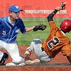 Gotcha: Junior Rex player Mitchell Howald tags a Charleston base runner during game action Saturday afternoon at Bob Warn Field.