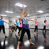 Tribune-Star/Joseph C. Garza<br /> Windmill like Pete: Bridget Ireland performs a Pete Townsend-like windmill guitar strum as she teaches participants in National Dance Day how to perform the day's hip hop dance at Teresa's School of Dance in the Meadows Saturday.