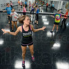 Tribune-Star/Joseph C. Garza<br /> Hip hop spin: Instructor Mandy Chapman spins with her fellow participants in National Dance Day at Teresa's School of Dance Saturday at the Meadows as they learn the day's hip hop dance.