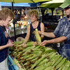 Tribune-Star/Joseph C. Garza<br /> Healthy ears: Jason Reisner of rural Cumberland County in Illinois peels back the husk of an ear of corn for customer Norma Shaw at the Farmers Market Saturday morning to show her how healthy it is.