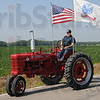 Homestead: Larry Burnett drives his antique tractor Friday afternoon. His homestead is the land behind the tractor off Curry Drive.